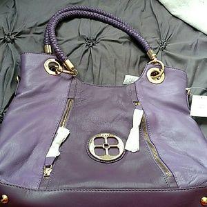 Iman brand new purple leather purse